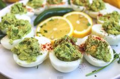 Guacamole Deviled Eggs /  Avocados, serrano chiles, and cilantro are finely chopped and combined with the cooked egg yolk.  Instead of paprika, the deviled eggs are dusted with New Mexico chile powder.