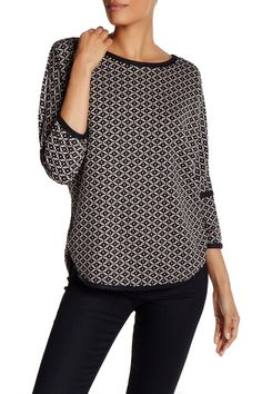 "Knit Jacquard Print Shirt by Max Studio  Details - Crew neck - Long sleeves - Allover print - Side vents - Curved hem - Approx. 25.5"" shortest length, 28"" longest length - Imported Fiber Content Shell: 79% polyester, 18% rayon, 3% spandex Contrast: 76% polyester, 20% rayon, 4% spandex $98.00"
