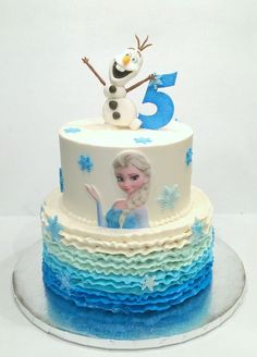 All buttercream including ruffles.  Olaf and other details are gumpaste.