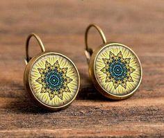 henna yoga earrings charm art picture mandala flower earrings om symbol buddhism zen statement earrings jewelry for women Buy Henna, Statement Earrings, Stud Earrings, Ear Candling, Music Symbols, Om Symbol, Bronze, Flower Mandala, Yoga