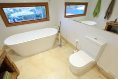 Bathroom trends - Freestanding Bath and Wall Faced Toilets Freestanding Bath, Bathroom Trends, Toilets, Corner Bathtub, Bathrooms, Wall, Freestanding Tub, Bathroom, Litter Box