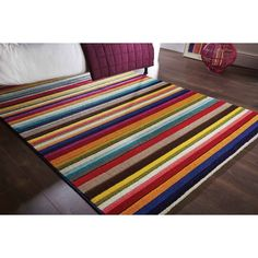 This wool rug is handmade and capable of adding a cheerful aura to your living rooms. This is made up of 100% wool. They are resistant to spills and fire. They are highly durable and soft.