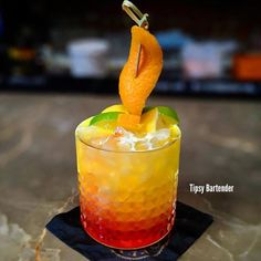 Check out the Orange Tower! Impress your friends with this stunning and well-crafted cocktail! For the recipe, visit us here: www.TipsyBartender.com