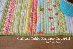 Easy quilt-as-you-go table runner tutorial - a great beginning quilting project or project for using up fabric scraps. Popular DIY sewing project.