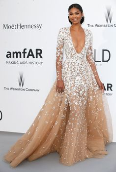 Pin for Later: The Cannes amfAR Gala Is a Sexy, Sparkling Fashion Dream Chanel Iman The model had a princess moment in a tulle Zuhair Murad Couture gown with white floral details.