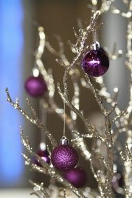 christmas ornaments on silver branches- great centerpiece; switch out gold for silver; add Victorian decor