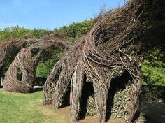 """Close up of the Stonehenge looking """"Easy Rider"""" by Patrick Dougherty. Love the leaves/hedge the sticks swirl around. #delight #inspiration"""