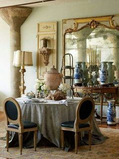 Intimate dining room in mixture of English and French country styles. Love the pilaster, mirror and standing lamp.