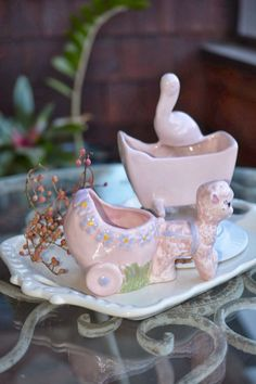 Fun retro baby planters, The Stork is by Haeger and the Lamb by Thomas Ceramics. These both are in pristine condition and would make a nice addition to your home.