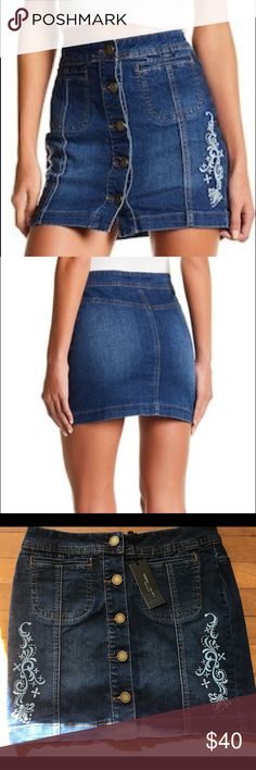 """Romeo Juliet Couture Embroidered Denim Mini Skirt Floral embroidery adds detail to a classic denim mini skirt.  Banded waist, Front button closure, A line silhouette, Paneled denim construction, 2 front welt pockets, Contrast topstitching, Embroidered side detail, Approx. 14.5"""" length (size S), 56% cotton, 22% rayon, 21% polyester, 1% spandex, Machine wash cold  Shipping: Within 24 hours.  All of my clothes come from a clean, smoke free and pet free environment. Romeo & Juliet Couture Skirts…"""