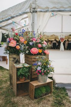Rustic Crates & Bright Wild Flower Display Wedding Decor - Helen Lisk Photography | Colourful Hanging Paper Lantern & Flower Filled Marquee Wedding | Bespoke Dresses & Tweed Suits