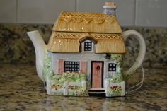 Seasons Teapot SPRING Cottage Tea Pot English This is a wonderful tea pot that is part of an English Country Cottage Seasonal Series. It measures approx. 7 inches high by 8 long and is in great condition. It would make a great addition to any collection or kitchen, and brings the spirit of the season into the home. This is a charming piece that will look great for years to come! $25.00
