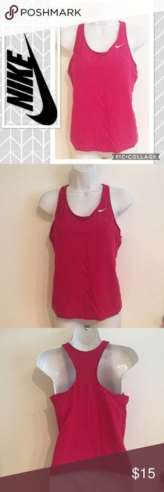 Nike Magenta Work Out Tank Nike Magenta colored Racerback workout tank with built in bra. Size large. Shows some minor wear.  #nike #magenta #racerback #tank #sport #bra #athletic #workout #active #punkydoodle  No modeling  Smoke free home I do discount bundles Nike Tops Tank Tops