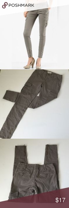 Free People Skinny Military Cargo Pants, 26 Free People soft skinny leg taupe cargo pants with zippers at ankles in size 26. Rise is 7.5 and inseam is 28.5. Button fly closure. Pieced material at knees. Large snap closure cargo pockets at either side. Darts slightly above knees. Button closure welt pockets on back.  98% Cotton, 2% Spandex. In excellent condition. Please ask if you have any questions. Free People Pants Ankle & Cropped