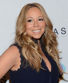 Mariah Carey Layered Cut - Mariah Carey a charity event for Project Canvas wearing her hair in long lightened layers.