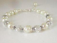 Ivory Pearl Bridal Bracelet, Ivory Bridesmaid Jewellery, Ivory Wedding Bracelet, Bridesmaid Gifts, Jewellery For Bride, Gift For The Bride by UrbanDaisyBridal on Etsy https://www.etsy.com/listing/181615508/ivory-pearl-bridal-bracelet-ivory