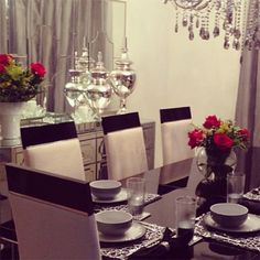 Luciane's #zgalleriemoment features a dazzling dining room with several reflective surfaces, including our Simplicity Buffet and Mirror, Montebello Jars, Mirage Tray and Omni Chandelier. Silver Nest Placemats and Chisel Glassware complete the look.