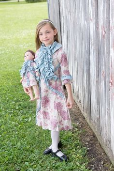This Brooke dress and its dreamy roses print is the perfect mix between classic elegance and playful ruffle details. #Handmade by #LilliLovebird #matchingdressforgirlanddoll #AmericanGirl #matchingcuteness