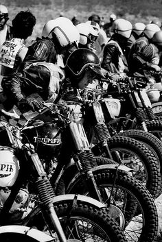 Steve McQueen racing. My quess is that this is a District 37 AMA Desert race . Back in the 60's the fastest motorcycles where Triumph Desert Sleds. You bought a street Triumph 650 twin and modified it. 100 mph down a desert road is what they did.