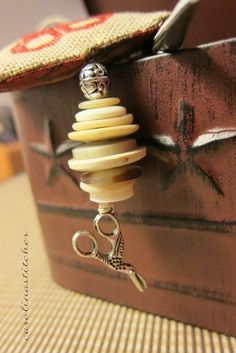 This was a fun fob to make...simple with old buttons and a charm.....