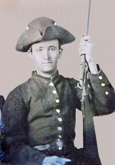Confederate Soldier with carbine. Many soldiers wore their hats as tri-corns invoking the Revolutionary spirit of '76.