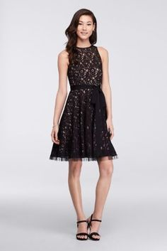 This fit and flare lace dress is equal parts stylish and sweet. The ultra-flattering shape is accented by an illusion neckline and a waist-defining sash that ties at the hip.  By Viola Chan  Lace  Back zipper  Hand wash  Imported