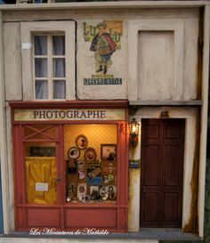 Miniature Photography Shop with living quarters above. Done in 1/12 scale.