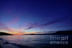 Magical sky is the high point in this west coast sunset at English Bay, Vancouver, British Columbia.