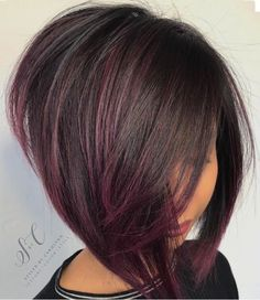 Asymmetrical brunette Bob burgundy highlights