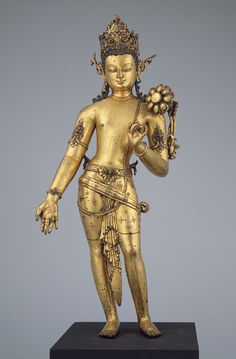 Bodhisattva Padmapani, bearer of the lotus. Nepal, copper alloy with gilding and semiprecious stones. Transitional period, 10th–11th C.