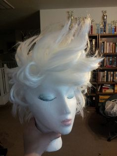 Ursula wig done. I bought a cheap white short one for $8 at Party City (it was originally a crazy scientist set) I just used a bunch of hair spray.  I curled sets of hair around my finger, or used a round brush for the longer sections.   I used a hair drier on a low setting to dry.  It only took a few hours.