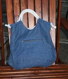 """bag -- reversible with ticking and appliqued flowers on one side and denim on the other. Rope handles. 17"""" wide 17"""" tall. 