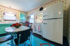 Love the Big Chill refrigerator in this 1940s style kitchen built new!