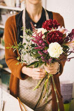 Florist holding beautiful bouquet by Danil Nevsky