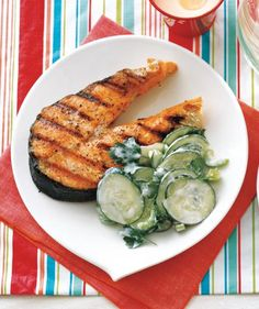 Don't feel confined to burgers and hot dogs at your barbecue. If your guests prefer a lighter main course, dish up this deliciously flaky salmon. The cucumber side salad is the perfect cool accompaniment to the freshly grilled fish.