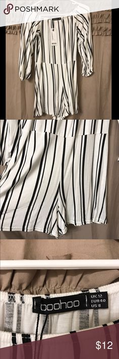 NWT Boo Hoo white & black off the shoulder romper NWT Boo Hoo white and black romper off the shoulder neckline with elastic. Cinched waist line, soft and flowy material. Size 8 US. Never been worn! Boohoo Dresses Mini