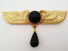Egyptian revival brooch by Jess Lelong. Gold plate and onyx stones