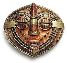 Elaborate belt buckle. I like the copper: Folk Art Masks From Africa   AFRICAN MASK Belt Buckle Tribal Art Review