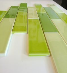 As seen on The Ellen Show: 2x8 American made ceramic subway tile from our Clayhaus for Modwalls collection. 24 glaze colors available. Shown here in 3 greens: Dill, Pear and Wheatgrass. www.modwalls.com