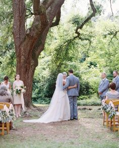 ceremony under a large tree on the front lawn of the Drengaelen House.