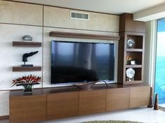 Contemporary entertainment center with tons of storage. Interior Design by Syril Lebbad Baer's Sarasota Store