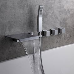 Architecturally inspired, Moda Collection of bathroom faucets takes the contemporary theme, featuring sleek, simplistic lines and a gorgeous water-efficient waterfall with an extremely flat spout. A waterfall spout delivers a large sheet of laminar w Master Bathroom Shower, Bathroom Taps, Bathroom Ideas, Bathtub Faucets, Bathrooms, Bathtub Ideas, Bathroom Inspiration, Sinks, Wall Faucet