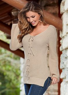 Stay cool in slouchy sweater vibes. Venus lace up detail sweater.