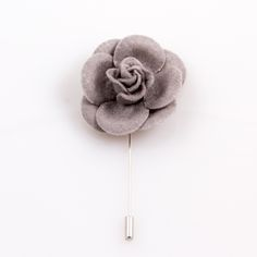 $12.99. www.ustylellc.com. Meticulously custom handmade in the USA to the most dapper of specifications. These gray  felt lapel flowers are a must have accessory. Each flower is handmade in the USA. Dimensions: Approximately 1.7 in diameter.  Stem is silver and measures 2.5 inches or 6.35 cm.  Description & Photo Copyright © 2014 Ubiquitous Style, LLC, www.ustylellc.com