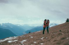 cute couple kissing in beautiful scenery mountains alps snow landscape photography