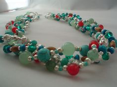 """I created this 21"""" long necklace with green and red jade, teal stabilized turquoise, green Austrian crystal, sterling silver plated beads and spacers and a few wooden spacers. It has a southwestern feel. I had a great time making it. $35.00. From my Etzy shop https://www.etsy.com/shop/IvanaMakes?ref=listing-shop-header-item-count"""