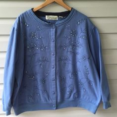 sweatshirt cardigan retro button front 3X Adorable blue button front cardigan in sweatshirt fabric light amount of beaded sequined embellished floral front. Inside is super soft and fuzzy looks to never have been worn retro peace by Shenanigans size 3X, Cotton polyester blend measures 56 inches around and 24.5 inches in length Vintage Jackets & Coats Blazers