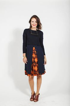 Jill gave dimension to her look by using layers. She paired her MADISON skirt with a long button down navy shirtdress and cropped black sweater. She finished her look with a simple gold bar necklace, gold bangle, LuLaRoe Trainers watch, and burgundy-brown open toe heels.