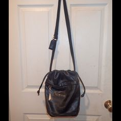 Vintage bucket bag Black genuine leather bucket bag front zip pocket with pull string closure one inside zip pocket gold detail from strap to bottom 30in 8 in wide 12 in long Vintage Bags Satchels