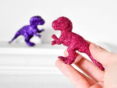 Baby T-Rex Dinosaurs in Fuchsia Pink, Grape Purple Glitter for Baby Shower Table Settings, Girly Girl Nursery Decor or Fun Home Decorations. $36.00, via Etsy.